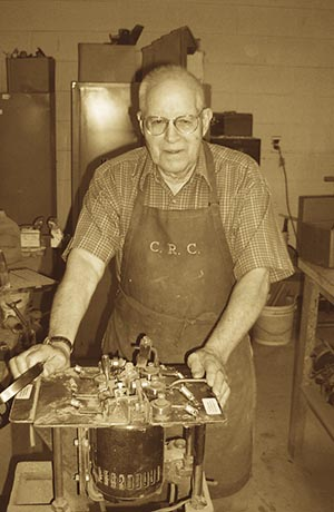 Raymond Schairer, at the age of 84, in his woodworking shop.